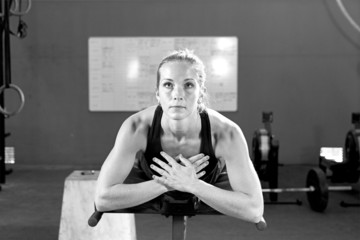 young woman at the abdominal crunch machine - crossfit workout.