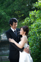 Bride and groom Embrace each other in the garden