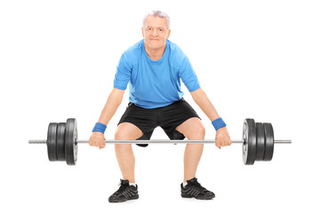 Strong mature man lifting a heavy weight