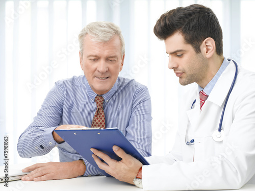 Consulting with doctor плакат