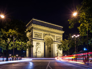 Arch of Triumph (Arc de Triomphe) at night with light trails
