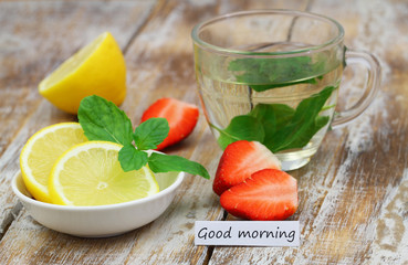 Good morning card with strawberries, mint tea and lemon