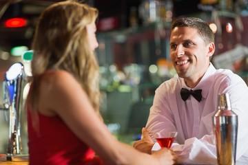 Barman chatting to pretty customer