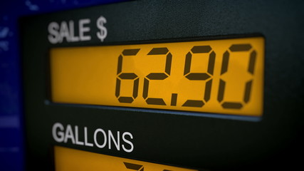 Closeup on gas pump display showing price of an arm and a leg
