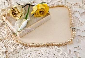 Delicate frame with dried flowers and pearl beads