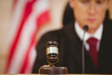 Stern judge about to bang gavel on sounding block