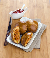 brioche stuffed with ham and ketchup