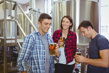 Young hipsters tasting beer together