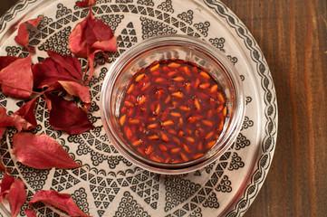 homemade pomegranate jam in a glass jar