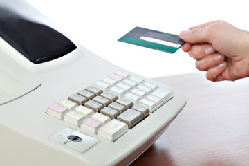 Cashier Holding Credit Card in Cash Register