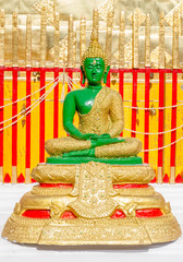 Green buddha on temple.