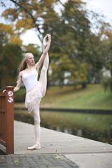Ballet leg extention; ballerina performing outdoors
