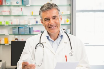 Happy pharmacist smiling at camera