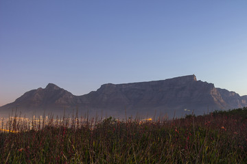 Table Mountain at dusk with city lights