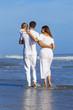 Man Woman Child Family Walking on Beach