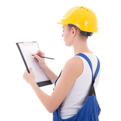 back view of young woman builder writing something on building p