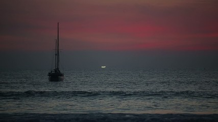 Phuket, Thailand. Boats in the sea at sunset n Thailand.