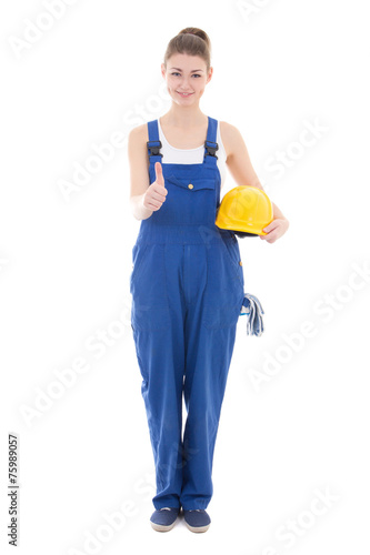 Leinwanddruck Bild young attractive woman builder in workwear thumbs up isolated on
