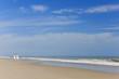 Happy Man Woman Child Family on Empty Beach
