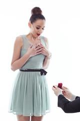Man making propose with wedding ring in gift box.