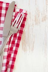 fork, knife and napkin