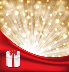 Gift box with red bow on glowing background