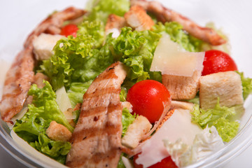 Delicious Caesar salad with chicken meat