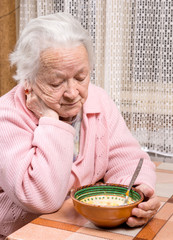 Old woman eating at home