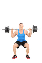 Strong man exercising with a barbell