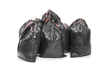 Bunch of garbage bags isolated on white background