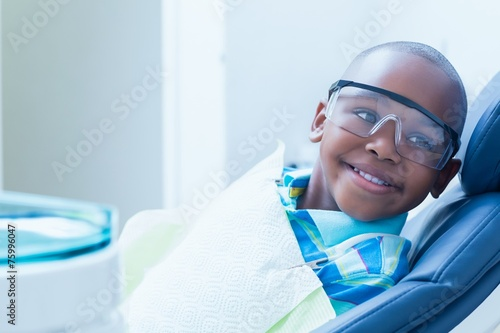canvas print picture Smiling boy waiting for dental exam