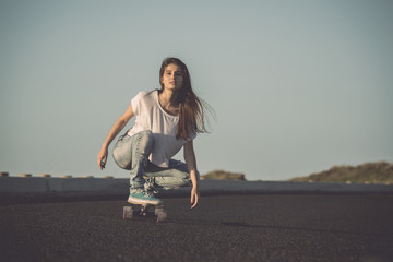 Skater girl making dowhill