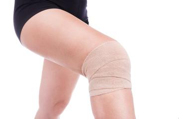Knee injury, bandaged an elastic bandage.