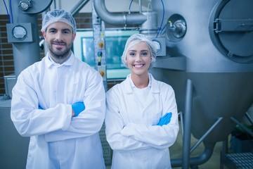 Food technicians smiling at camera