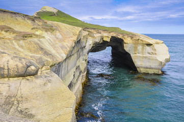 Natural arch at Tunnel beach, Otago Peninsula, New Zealand