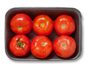 Red tomatoes in a plastick pack. Isolated.