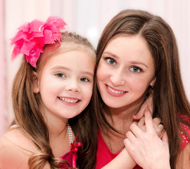 Smiling young woman and her little girl