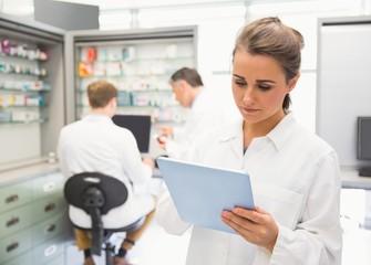 Junior pharmacist using tablet pc
