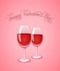 Glasses of wine on pink background