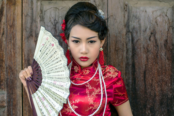 Chinese woman red dress traditional cheongsam