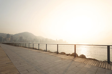 skyline and street near the harbor of hong kong in daytime,