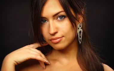 Beautiful young woman portrait. Jewelry and diamonds