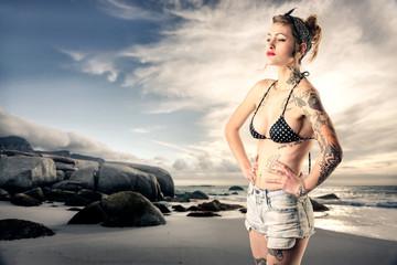 Tattooed girl at the beach