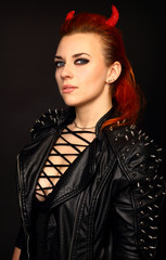 Rocker or Punk Woman with red horns on black background