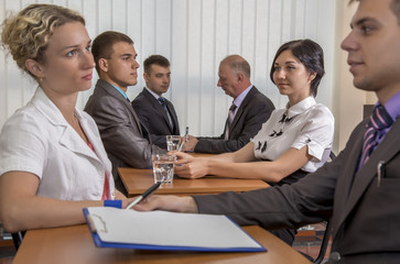 Many business people are passing interview