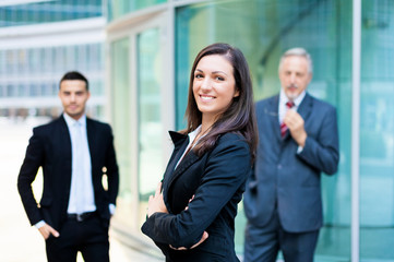 Businesswoman in front of a group of business people