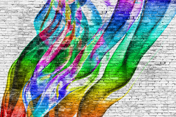 abstract colorful painting over brick wall