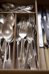 Silver Cutlery Arranged In Drawer