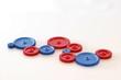 Leinwanddruck Bild - Zahnräder aus Kunststoff in blau und rot