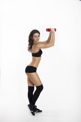 Beautiful fitness girl in black with red dumbbells